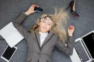 Women burned out with work.